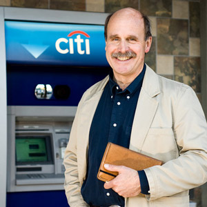 Futurist Paul Saffo in front of an ATM