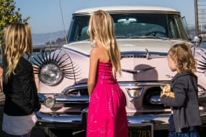 Oldtimer car admired by three girls in San Francisco
