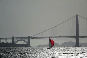 Sailboats and kite surfers at the Golden Gate Bridge