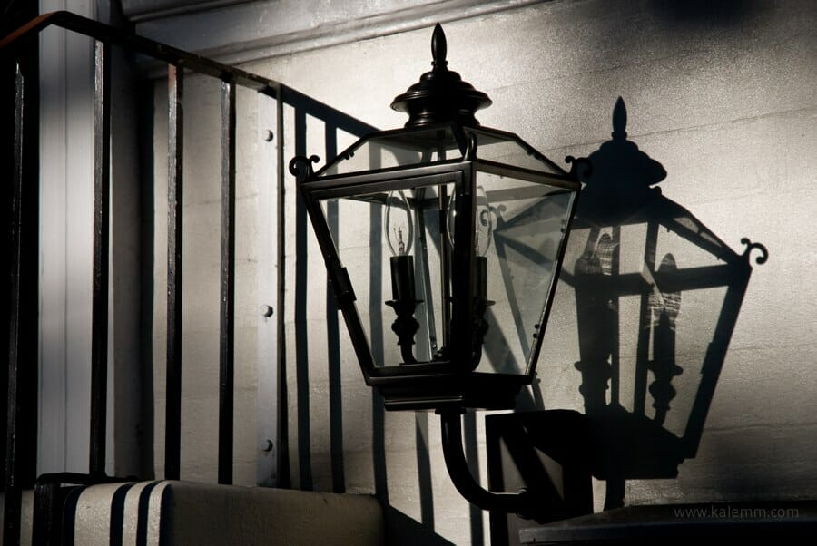 Artisan lamp, casting shadow in afternoon light