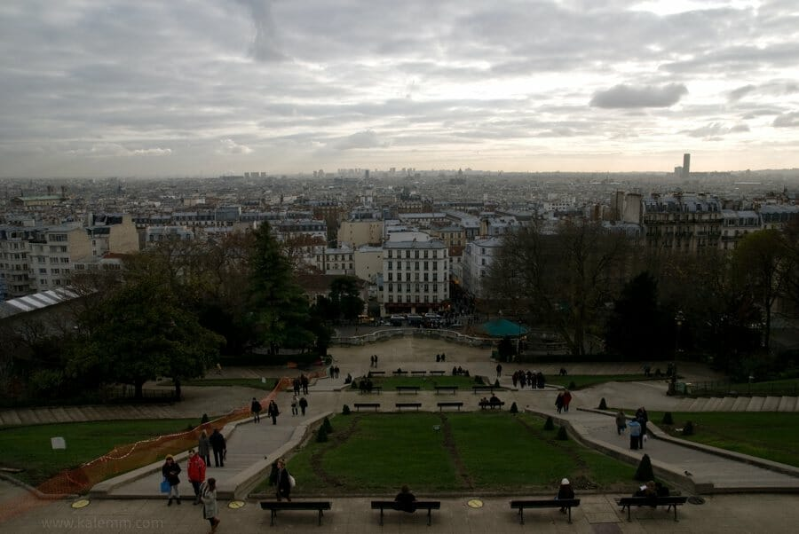 Paris skyline seen from Sacré-Coeur, steps of Montmartre on cloudy day