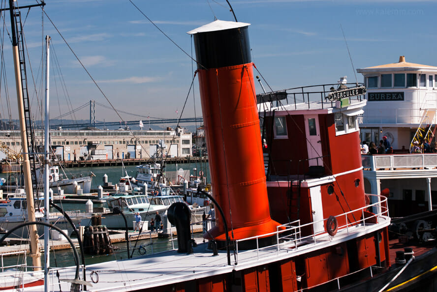 Museum ships Hercules and Eureka with San Francisco skyline