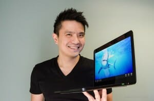 Razer CEO, co-founder Min-Liang Tan holding a Razer Blade laptop