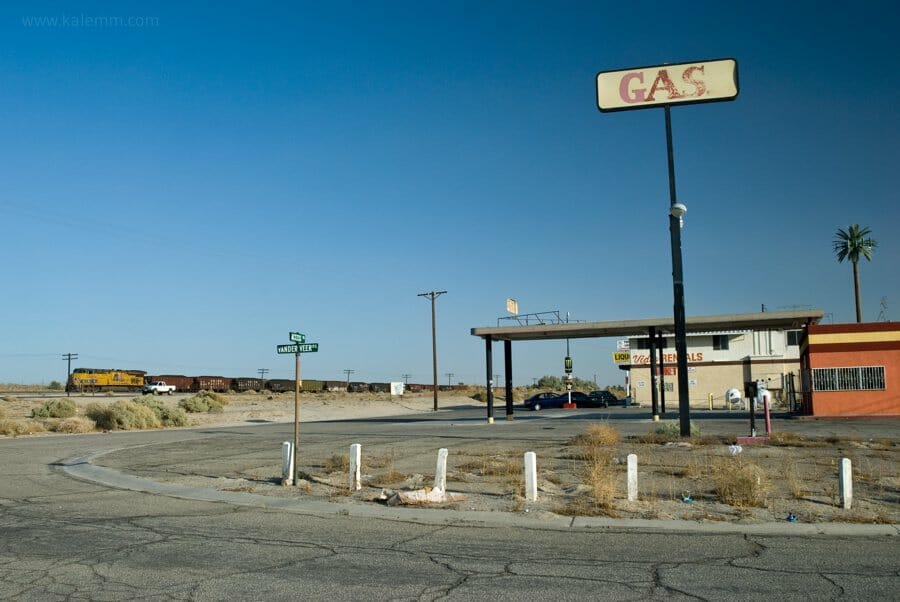 Train and gas station in California desert near Salton Sea