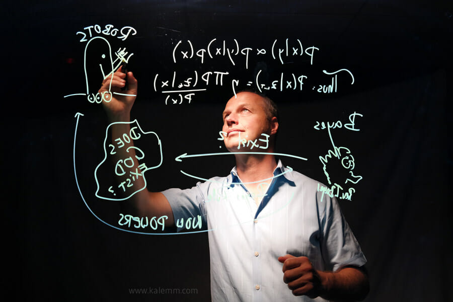 Udacity founder Sebastian Thrun writing math formula