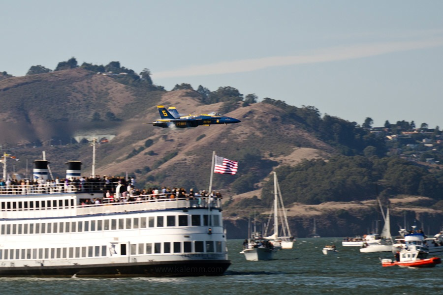 Blue Angels jet with boats