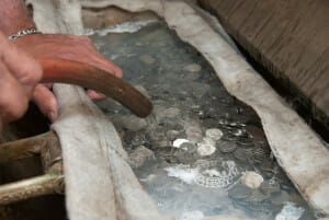 dirty coins being washed